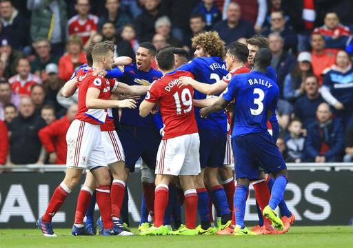 Tempers flare between Middlesbrough and Manchester United players during their English Premier League soccer match at the Riverside Stadium, Middlesbrough, England, Sunday, March 19, 2017. (Nigel French/PA via AP)