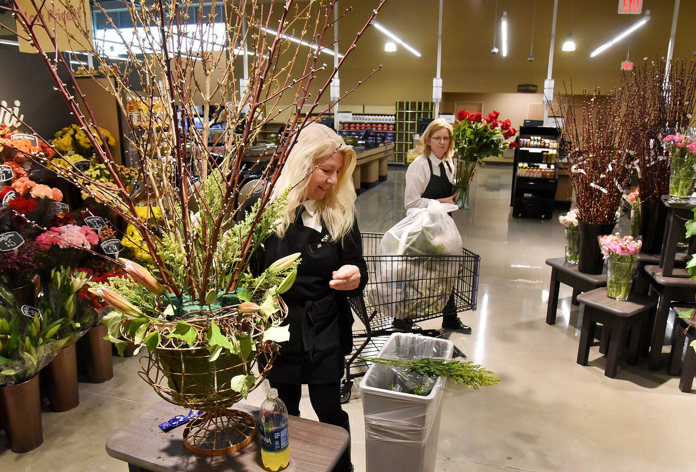 Jill Johnson, left, and Mary Beth White put finishing touches to the floral department of the new Mariano's in Des Plaines. The store opens to the public at 6 a.m. Tuesday.
