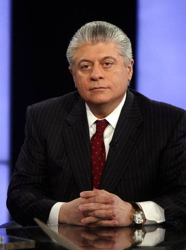 "FILE- In this April 11, 2011, file photo, Andrew Napolitano appears on the ""Varney & Co."" program on the Fox Business Network, in New York. Fox News Channel has pulled legal analyst Napolitano from the air after disavowing his on-air claim that British intelligence officials had helped former President Barack Obama spy on Donald Trump.  The move was first reported by The Los Angeles Times on Monday, March 20, 2017."
