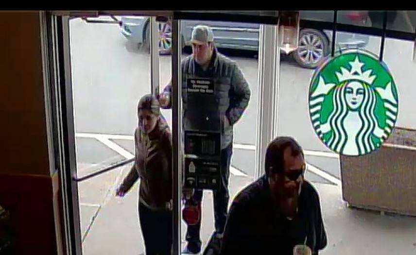 Police suspect these two people in the doorway of Starbucks stole a woman's wallet.