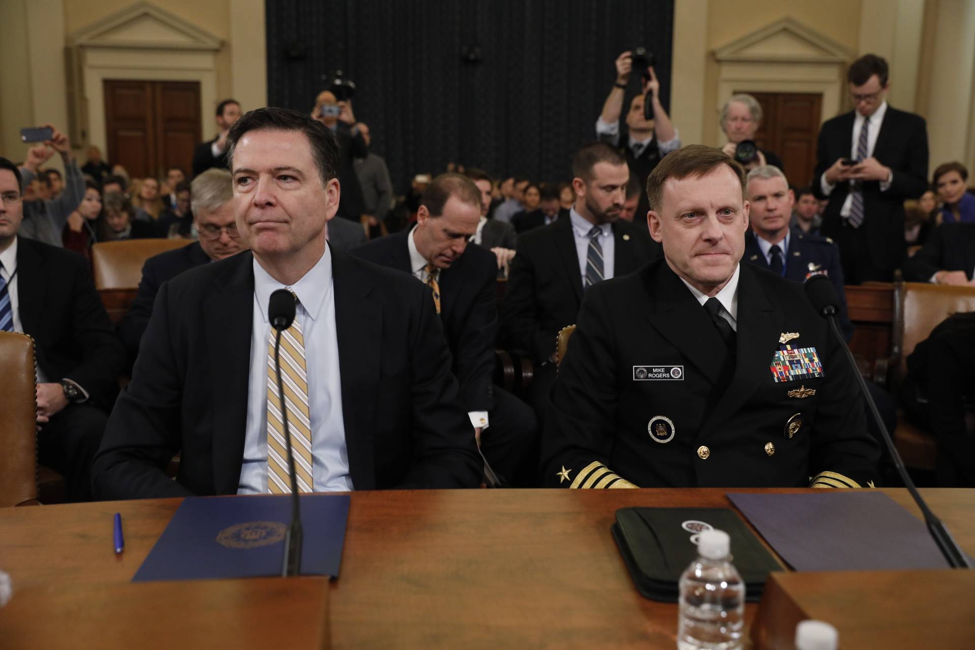"James Comey, director of the Federal Bureau of Investigation (FBI), left, confirmed Monday that an investigation into Russian interefence in the 2016 election is also exploring whether there was any coordination between the Trump campaign and the Kremlin, and ""whether any crimes were committed."""