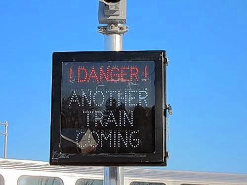 Some suburban stations on Metra's UP West Line have warning devices that alert people of a second train.