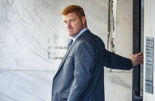 "Former Penn State assistant football coach Mike McQueary leaves the Dauphin County Courthouse after he testified at the trial of Graham Spanier, Tuesday, March 21, 2017, in Harrisburg, Pa. The failure of Penn State's former president to report child molestation accusations against Jerry Sandusky allowed evil ""to run wild,"" prosecutors said Tuesday at the start of Spanier's trial. (Dan Gleiter/PennLive.com via AP)"