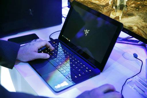 FILE - In this Jan. 7, 2016 file photo, a laptop is seen in Las Vegas. Royal Jordanian Airlines is advising passengers that laptops, iPads, cameras and other electronics won't be allowed in carry-on luggage for U.S.-bound flights starting Tuesday, March 21, 2017.