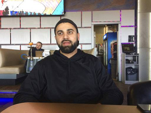 "In this photo taken March 16, 2017, Hussein Dabajeh, 30, a lifelong Dearborn, Mich. resident who owns a hookah shop and lounge, said his ancestors first came to the U.S. from what's now Lebanon in 1911. Still, he usually looks for the ""other� box when offered the option on official forms and fully supports the idea of a new category for those who trace their roots to the Middle East."