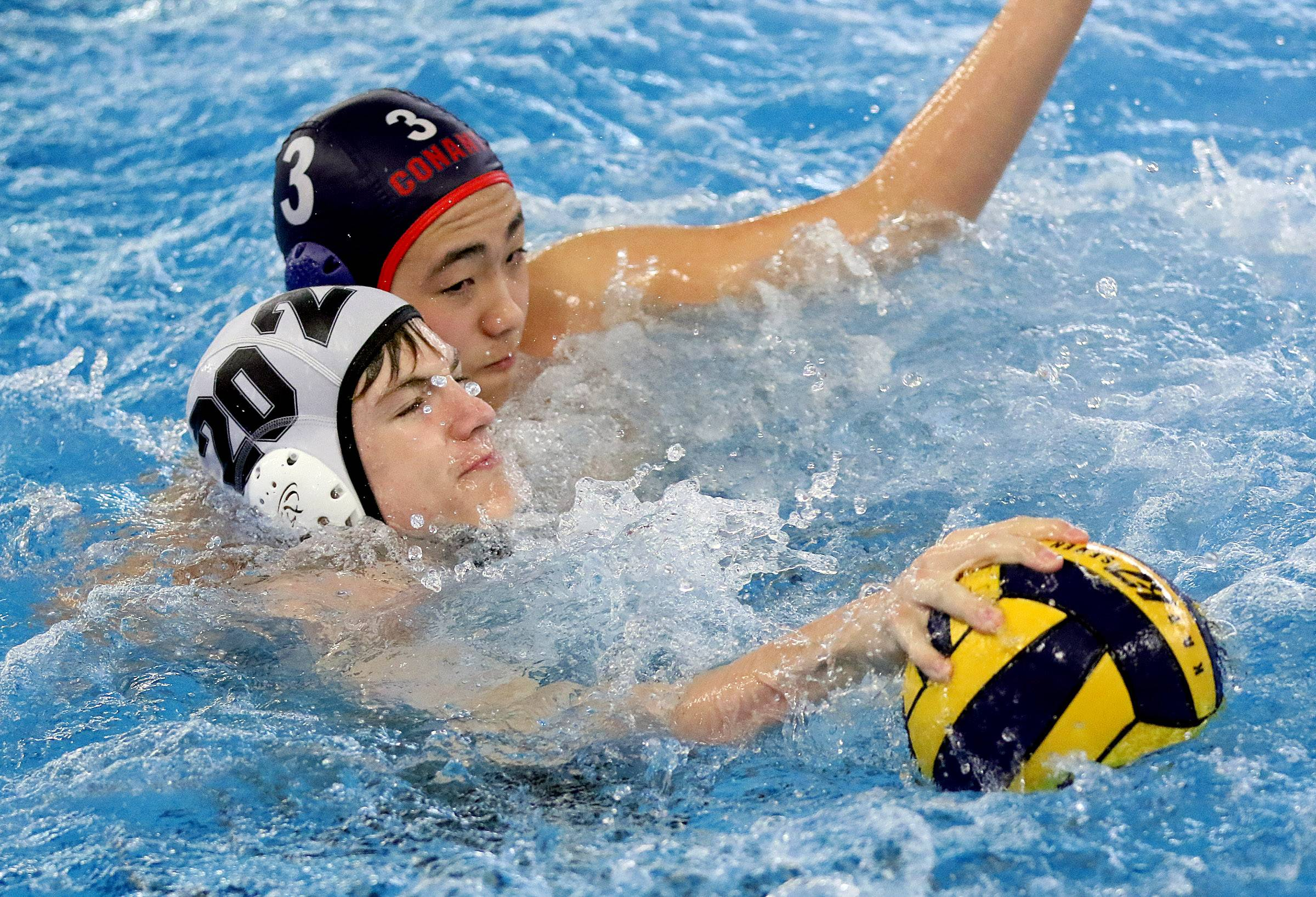Barrington's Steven Fischer (20) battles with Conant's Bryan Cho on Monday in Hoffman Estates.