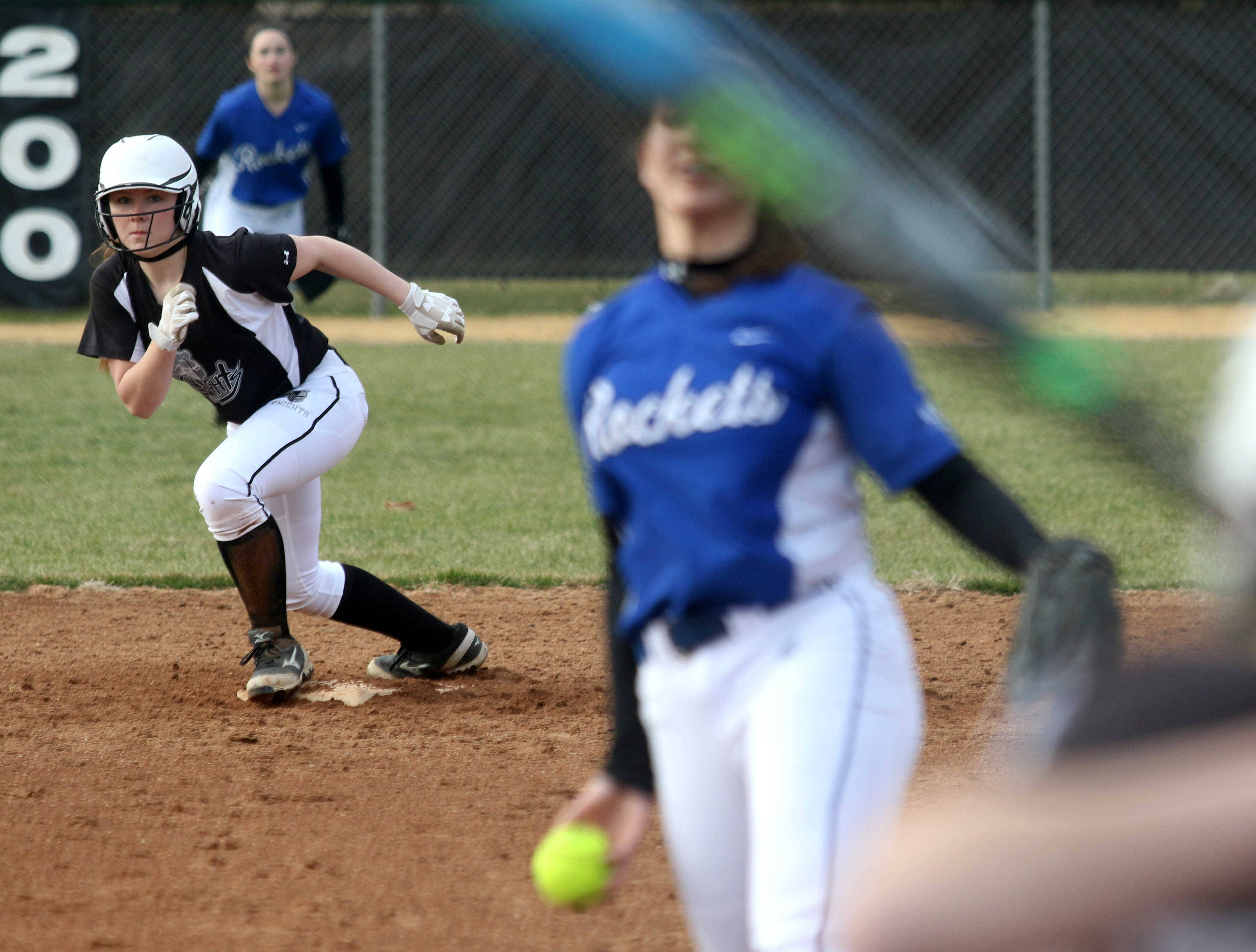 Kaneland's Maddy Wheatley gets a jump at second base as Burlington Central pitcher Julia Barnes delivers to home during varsity softball action at Kaneland Monday night.