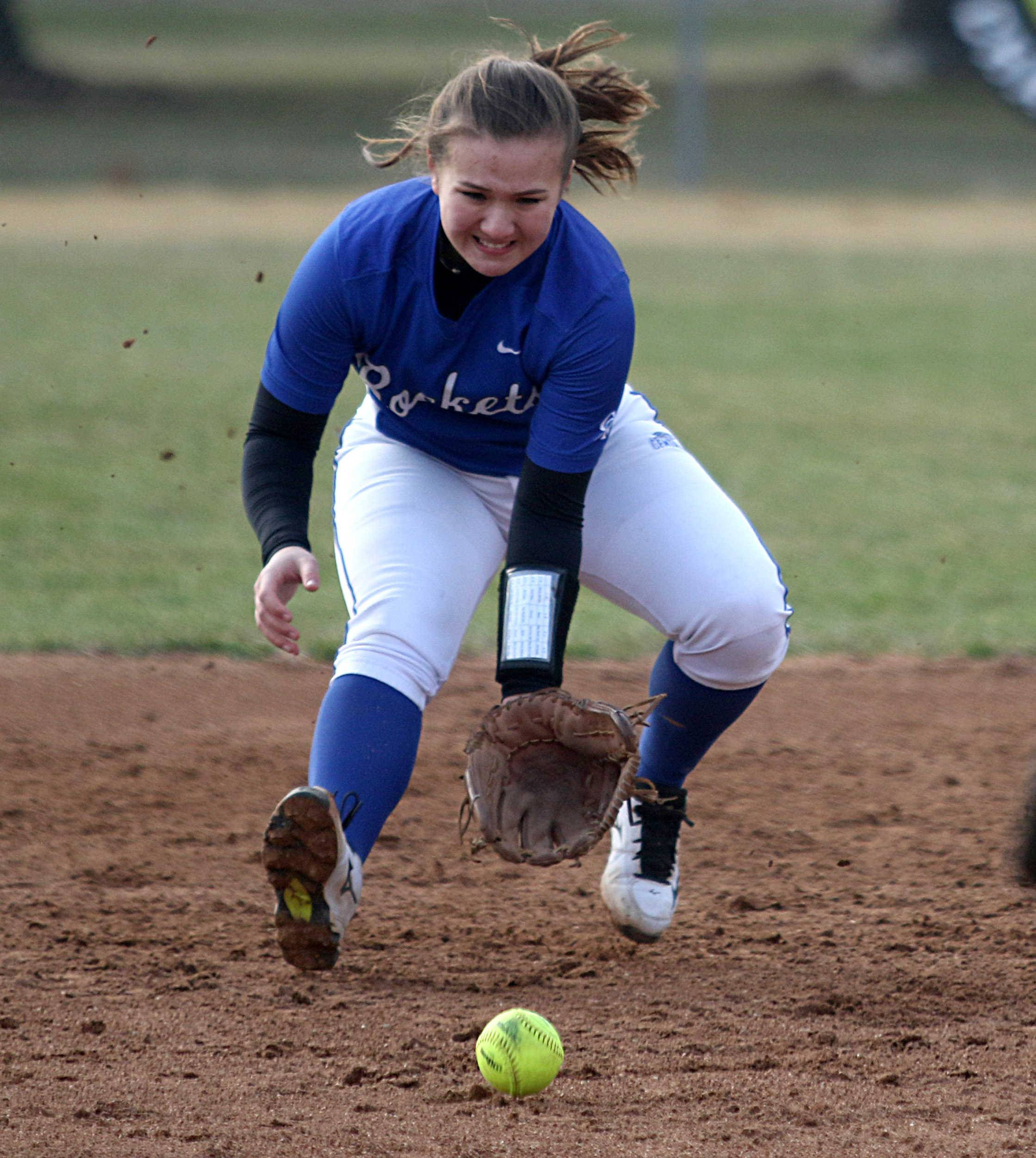 Burlington Central shortstop Kristina Ahlers fields a grounder during varsity softball action at Kaneland Monday night.