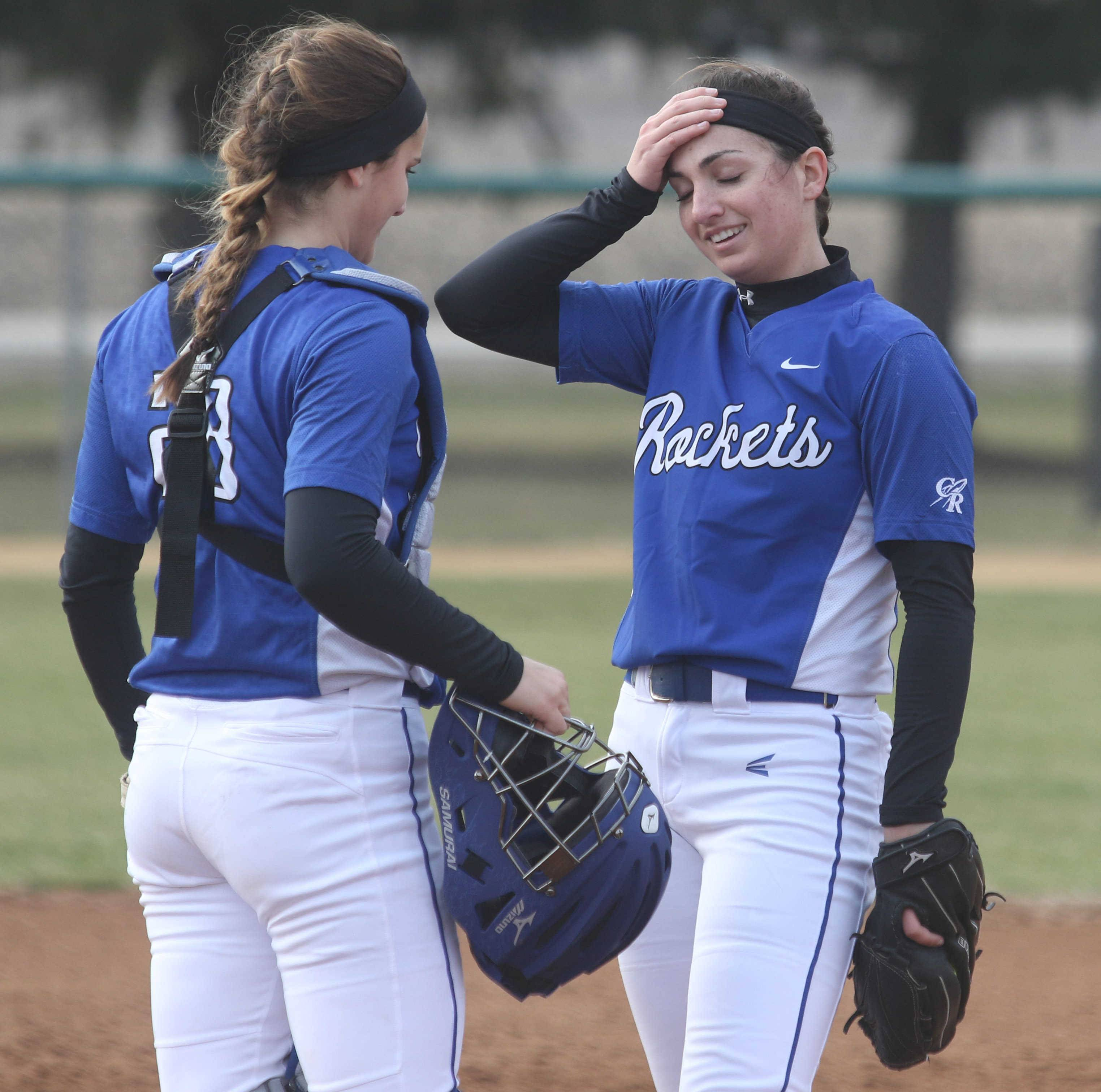 Burlington Central catcher Lindsay Jamrozek, left, meets with pitcher Julia Barnes during varsity softball action at Kaneland Monday night. Barnes earned the win in Kaneland's 4-2 victory while Jamrozek had 3 hits and 4 RBI.