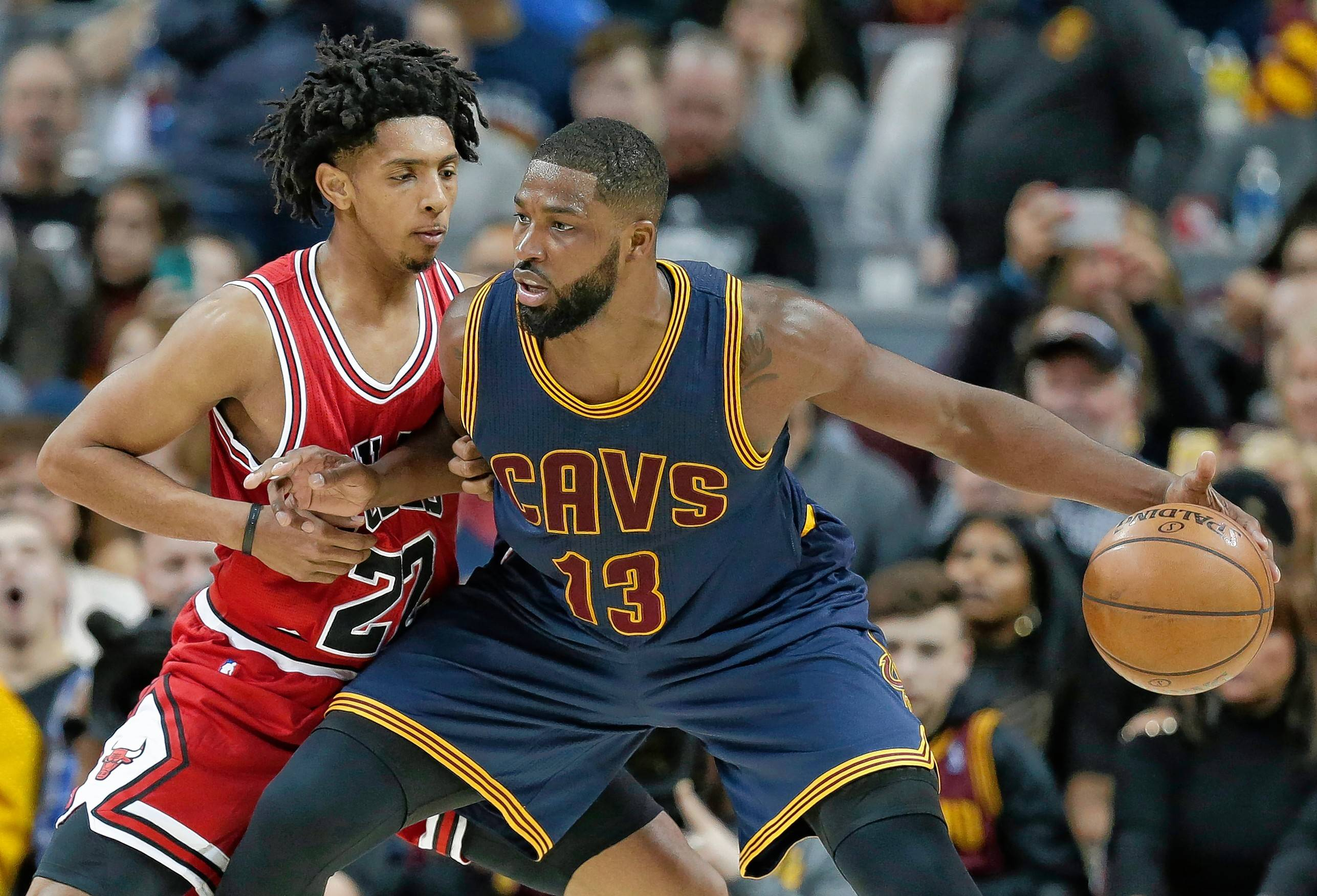 Cleveland Cavaliers' Tristan Thompson, right, drives past Chicago Bulls' Cameron Payne in the first half of an NBA basketball game, Saturday, Feb. 25, 2017, in Cleveland.