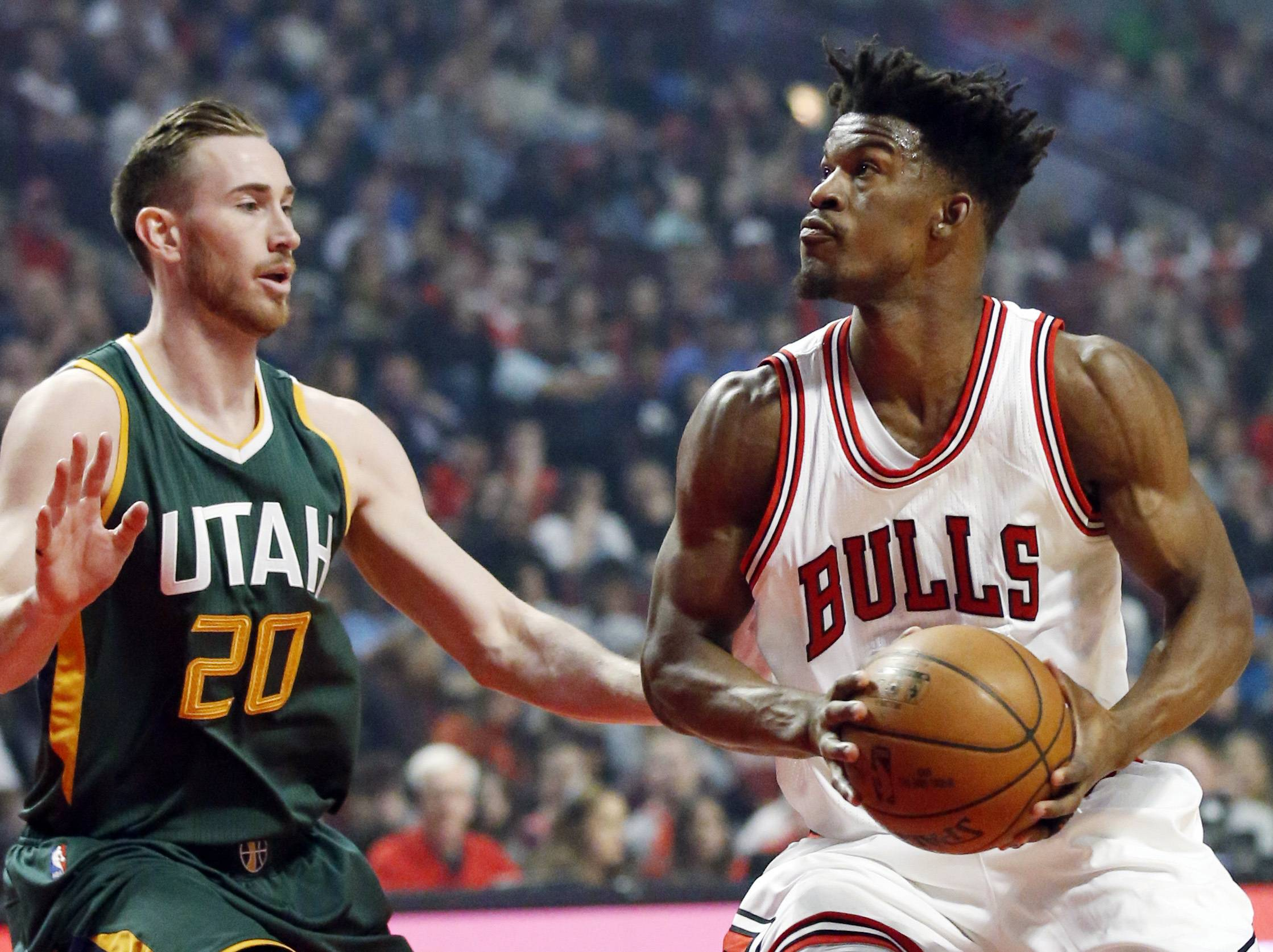 Chicago Bulls guard/forward Jimmy Butler, right, looks to the basket as Utah Jazz guard/forward Gordon Hayward guards during the first half of an NBA basketball game Saturday, March 18, 2017, in Chicago.