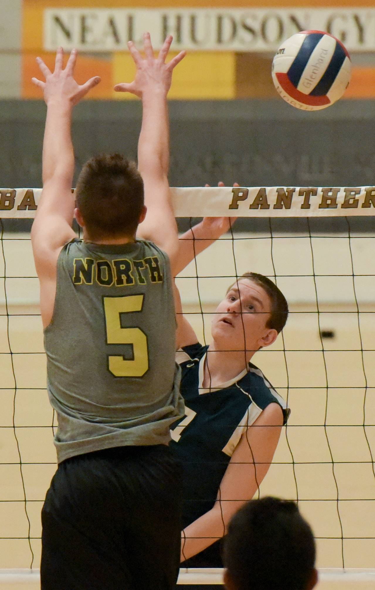 Addison Trail's Michael Strycharz fires one past Glenbard North's Trent Weber during varsity boys volleyball Monday in Carol Stream.