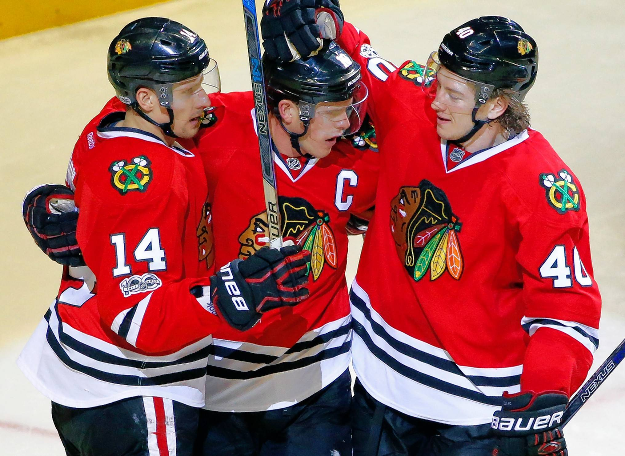 Chicago Blackhawks center Jonathan Toews, center, celebrates with left wing Richard Panik, left, and center John Hayden after scoring his goal against the Colorado Avalanche during the third period of an NHL hockey game Sunday, March 19, 2017, in Chicago. The Blackhawks won 6-3.