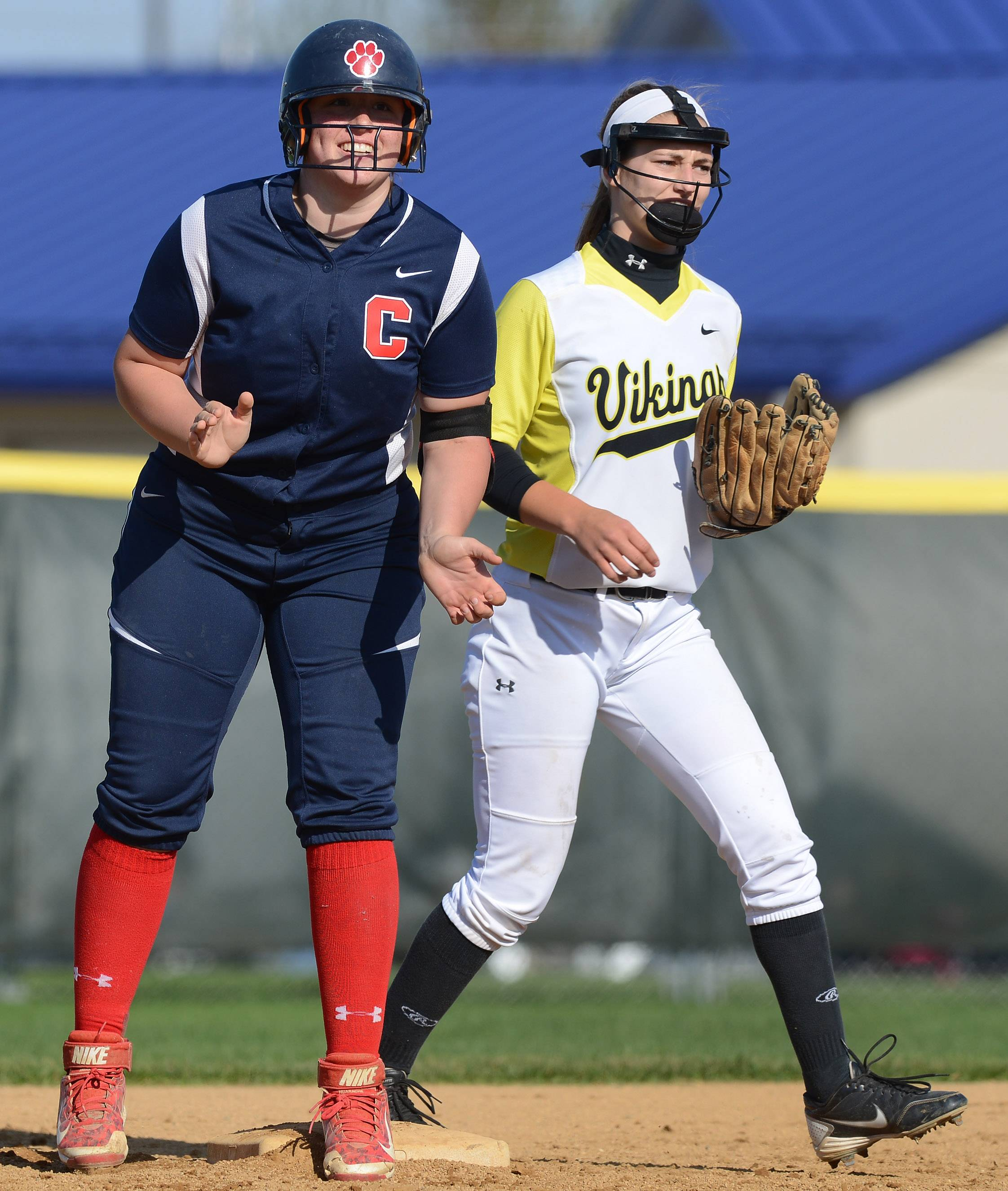 Conant's Morgan Bihun, here celebrating an RBI double as Fremd's Becca Uhrich covers second base, is headed for a collegiate softball future at Wisconsin-Green Bay.