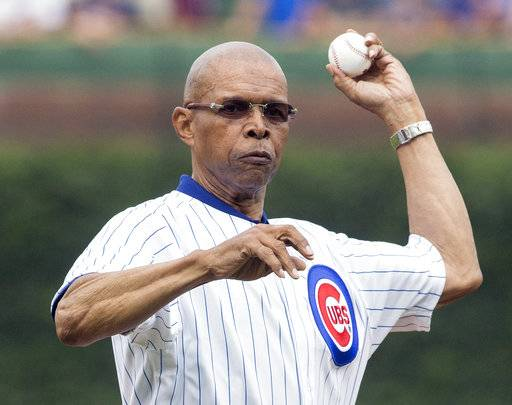 FILE - In this July 11, 2014, file photo, former Chicago Bears NFL football player Gale Sayers throws out a ceremonial first pitch before a baseball game between the Chicago Cubs and Atlanta Braves, in Chicago. Relatives of Pro Football Hall of Famer Gale Sayers say the Bears legend has been diagnosed with dementia. His wife, Ardythe Sayers, tells The Kansas City Star that her 73-year-old husband was diagnosed four years ago and she blames Sayers' football career. He played for the Bears from 1965-71 after setting records at the University of Kansas.