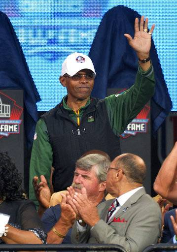 FILE - In this Aug. 2, 2014, file photo, Gale Sayers is introduced during Pro Football Hall of Fame enshrinement ceremonies in Canton, Ohio. Relatives of Pro Football Hall of Famer Gale Sayers say the Bears legend has been diagnosed with dementia. His wife, Ardythe Sayers, tells The Kansas City Star that her 73-year-old husband was diagnosed four years ago and she blames Sayers' football career. He played for the Bears from 1965-71 after setting records at the University of Kansas.
