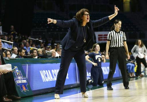 Quinnipiac head coach Tricia Fabbri watches the action during the first half of a first round game against the Marquette in the NCAA women's college basketball tournament, Saturday, March 18, 2017, in Coral Gables, Fla. Quinnipiac won 68-65.