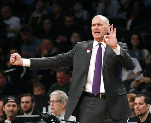 Dallas Mavericks head coach Rick Carlisle gestures in the first half of an NBA basketball game against the Brooklyn Nets, Sunday, March 19, 2017, in New York.
