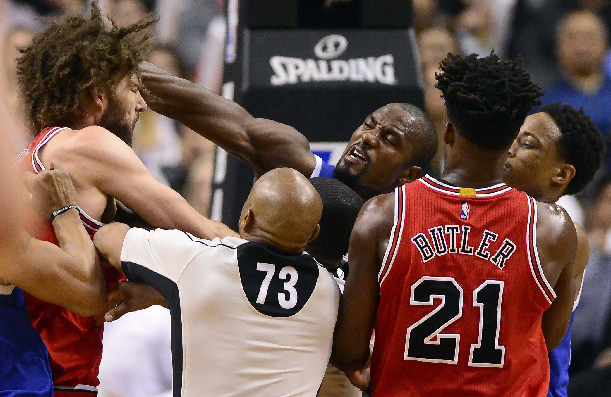 Toronto Raptors' Serge Ibaka, center, strikes Chicago Bulls' Robin Lopez, left, during a scuffle in the second half of an NBA basketball game in Toronto, Tuesday, March 21, 2017. (Frank Gunn/The Canadian Press via AP)