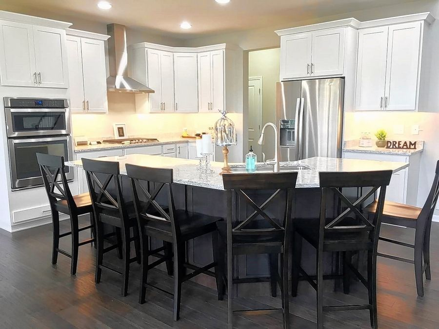Upgraded kitchen features, such as high-end cabinetry and appliances, are common selections.