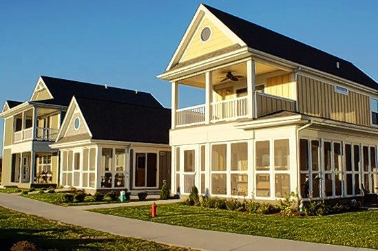 Screened porches are a popular option at the Cottages at Heron's Landing neighborhood at Heritage Harbor Ottawa Resort.