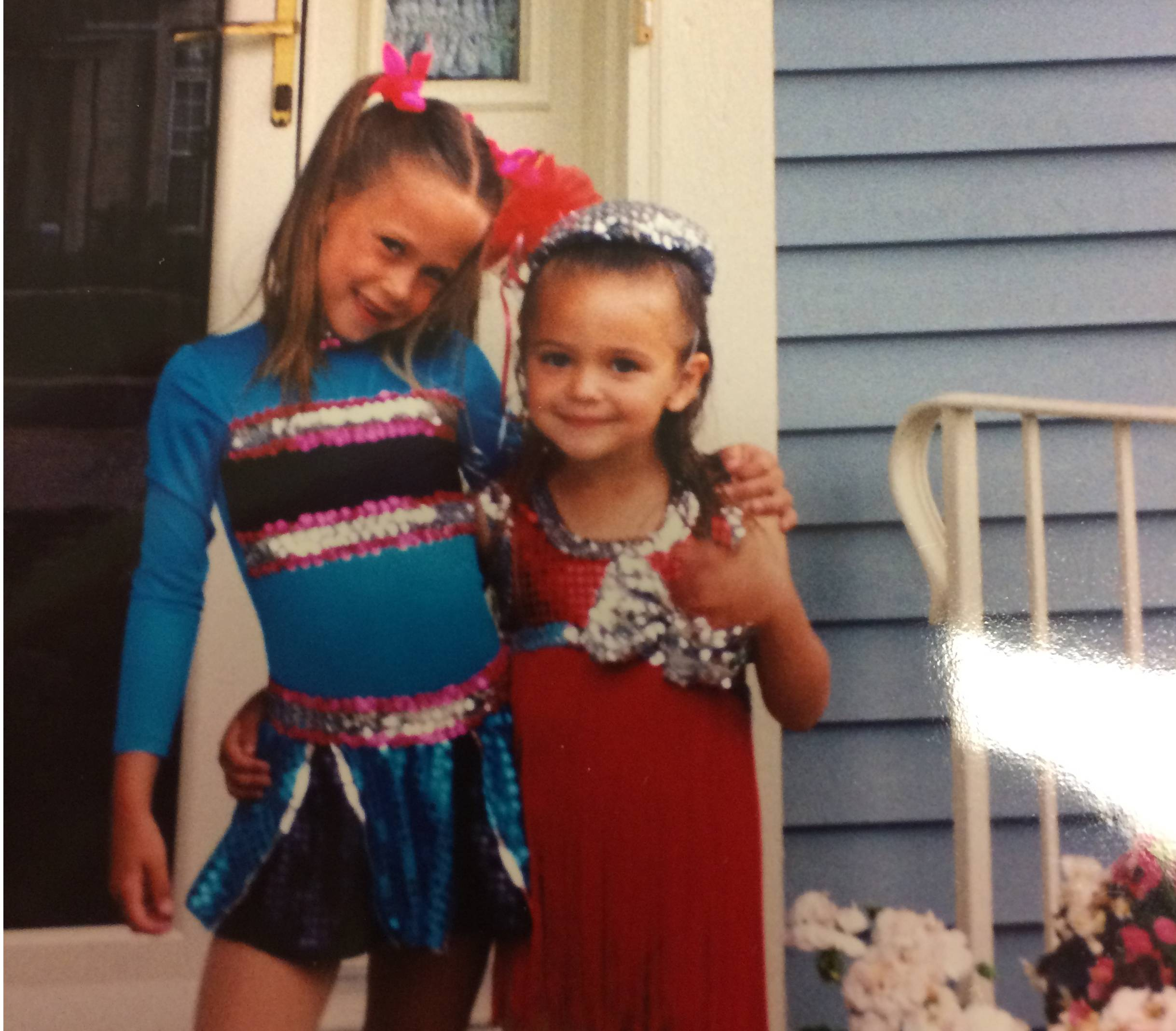 Alexis, in blue, and her sister Ariel pose in their dance costumes.