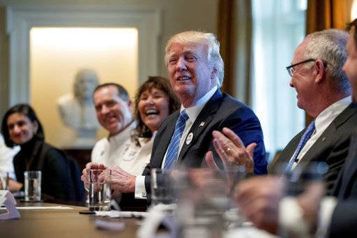 President Donald Trump meets with truckers and industry CEOs regarding healthcare, Thursday, March 23, 2017, in the Cabinet Room of the White House in Washington. (AP Photo/Andrew Harnik)