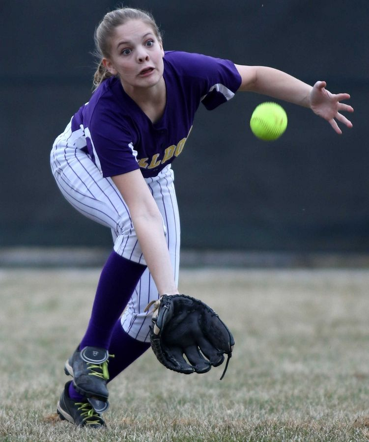Wauconda's Sydney Rodgers sprints in for a flyball against Marengo at Wauconda on Friday evening.