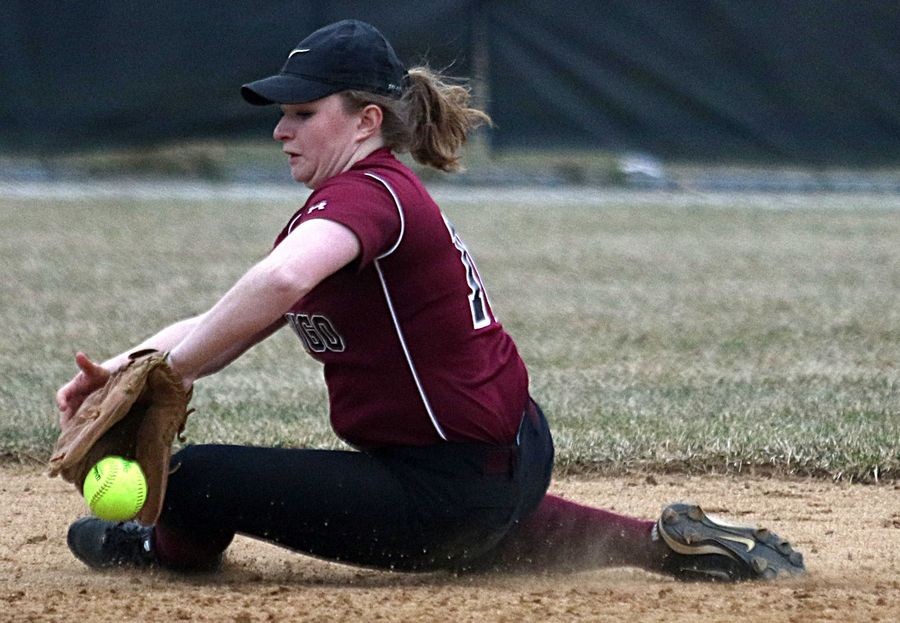 Marengo's Anna Walsweer makes a diving stop on the final play of the Indians' win during varsity softball at Wauconda on Friday evening.