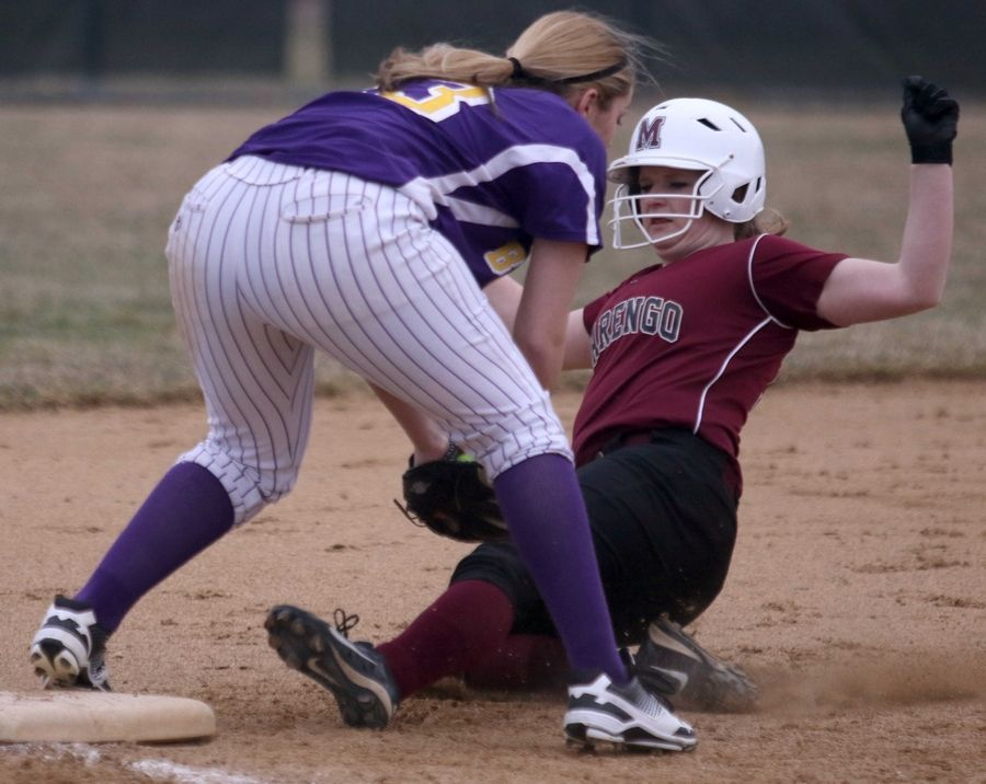 Marengo's Anna Walsweer is forced out at third base as Wauconda's Mallory Carver steps on the bag at Wauconda on Friday evening.