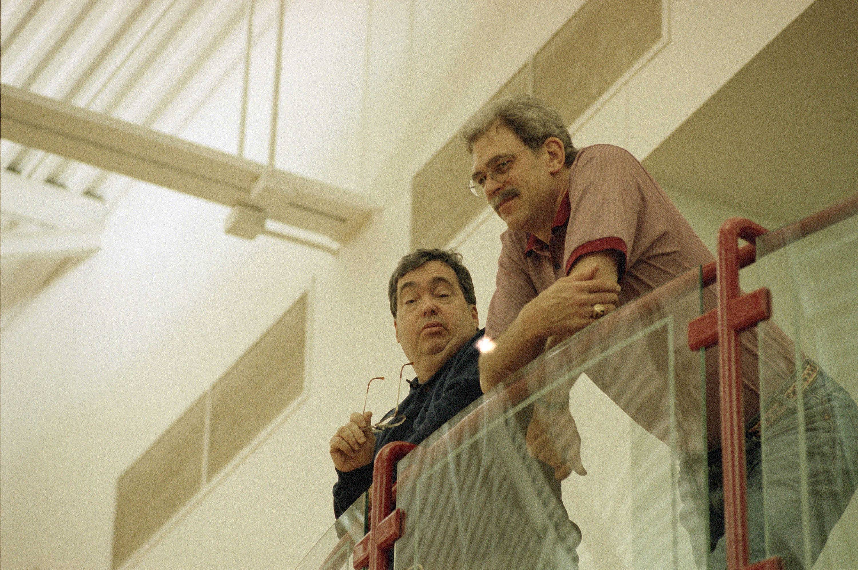 Bulls' coach Phil Jackson and general manager Jerry Krause watch Bulls practice from above at the Berto Center in 1995.