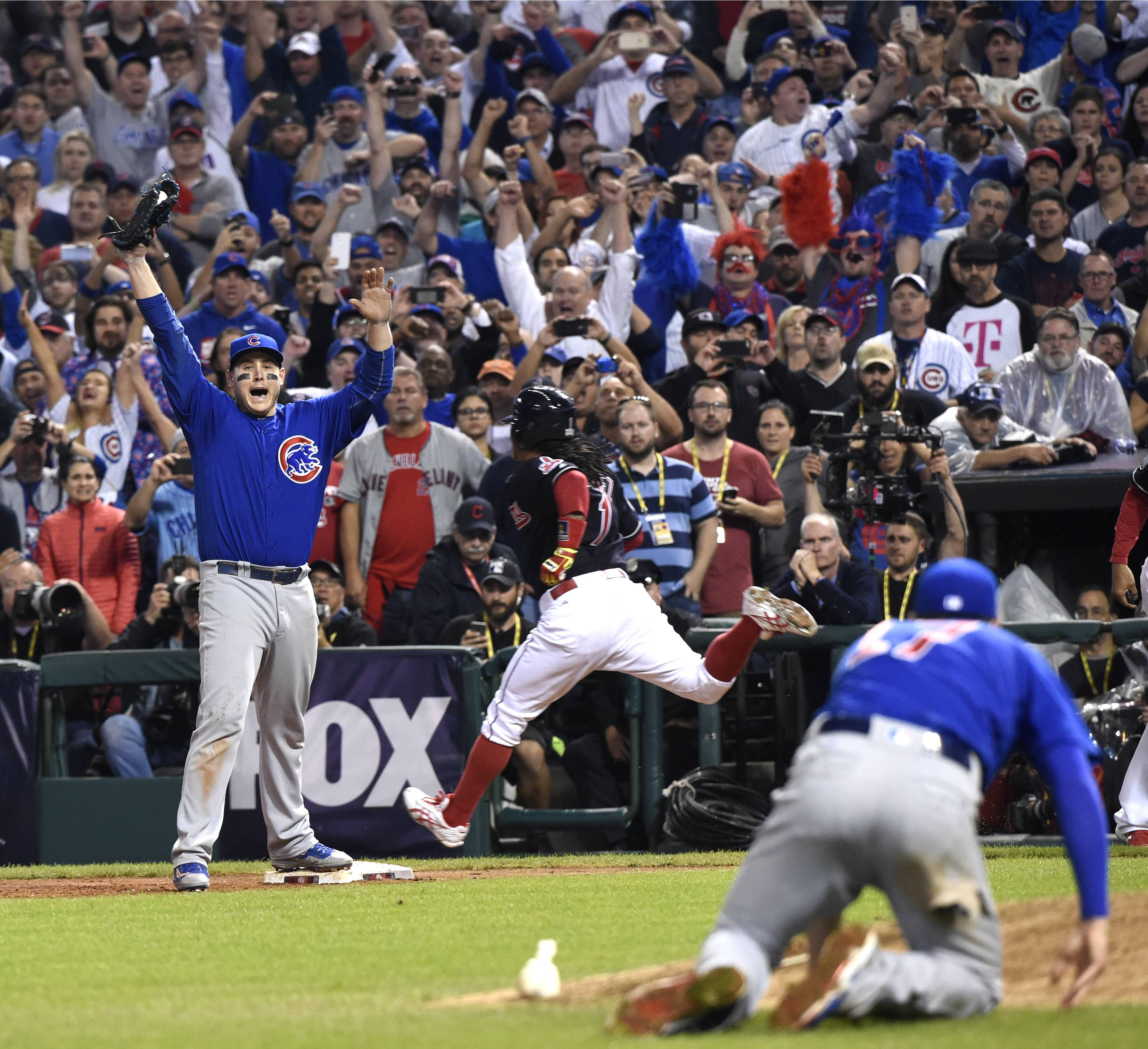 With Kris Bryant on the ground after making the throw, Anthony Rizzo catches the final out of Game 7 of the 2016 World Series and the Cubs begin their celebration at Progressive Field in Cleveland.