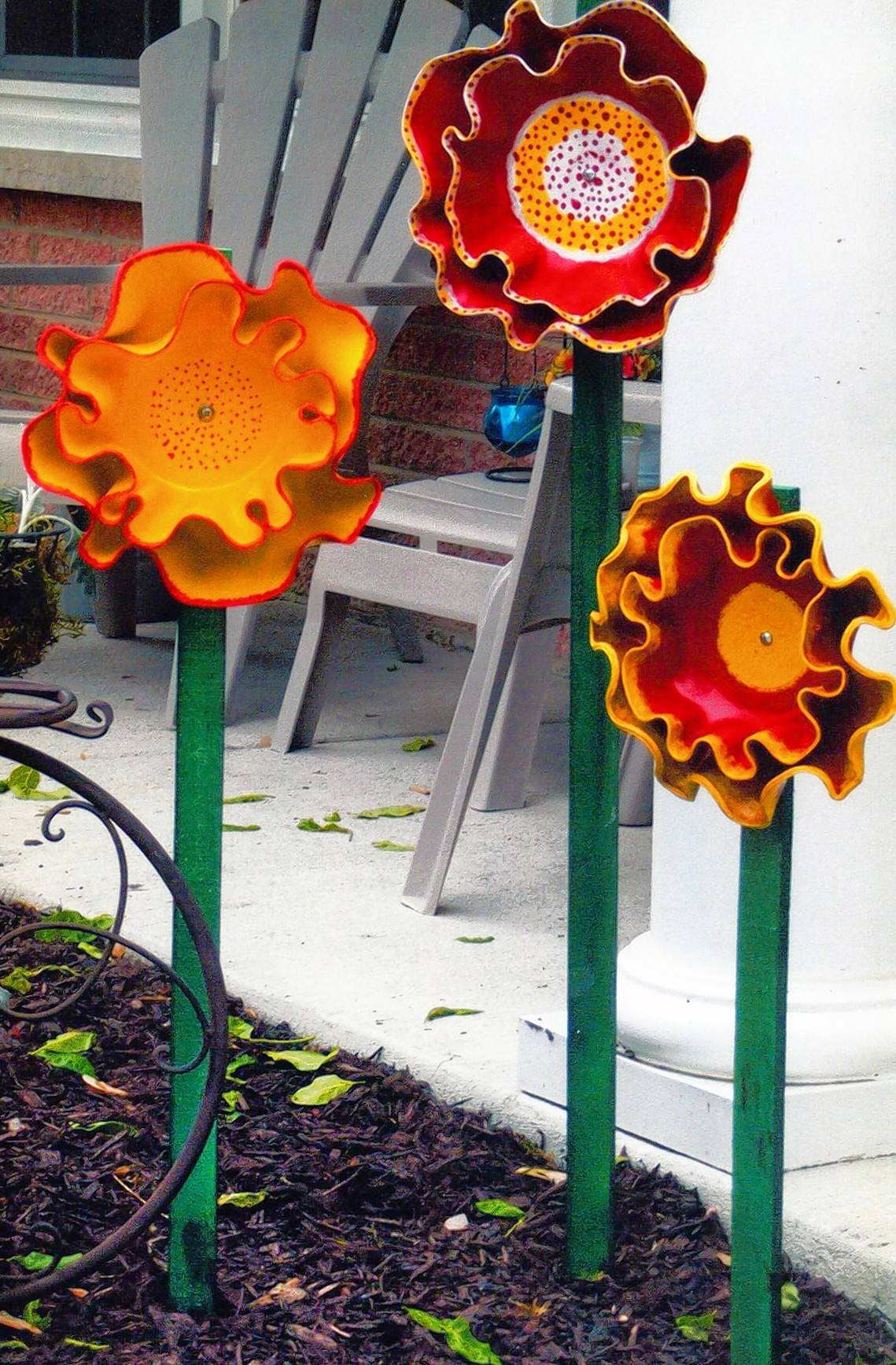 GRAND PRIZE WINNER: Josephine Perez of Arlington Heights creates her Fantasy Flowers by melting old vinyl record albums in the oven, then painting and assembling them into flowers. The flowers can be staked in a garden or flower bed, or attached to fencing or a shed. She also makes mushroom caps that can top jars nestled in the dirt.