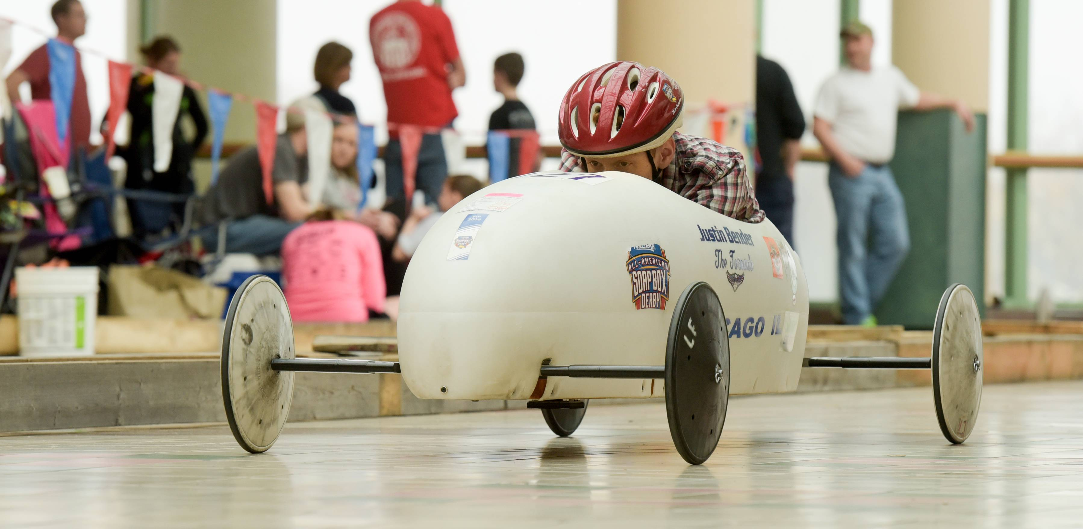 Justin Bender, 16, of Wauconda competes Sunday in the Greater Chicago Soap Box Derby Races at Charlestowne Mall in St. Charles. More than 30 drivers from across the Midwest competed in the races.