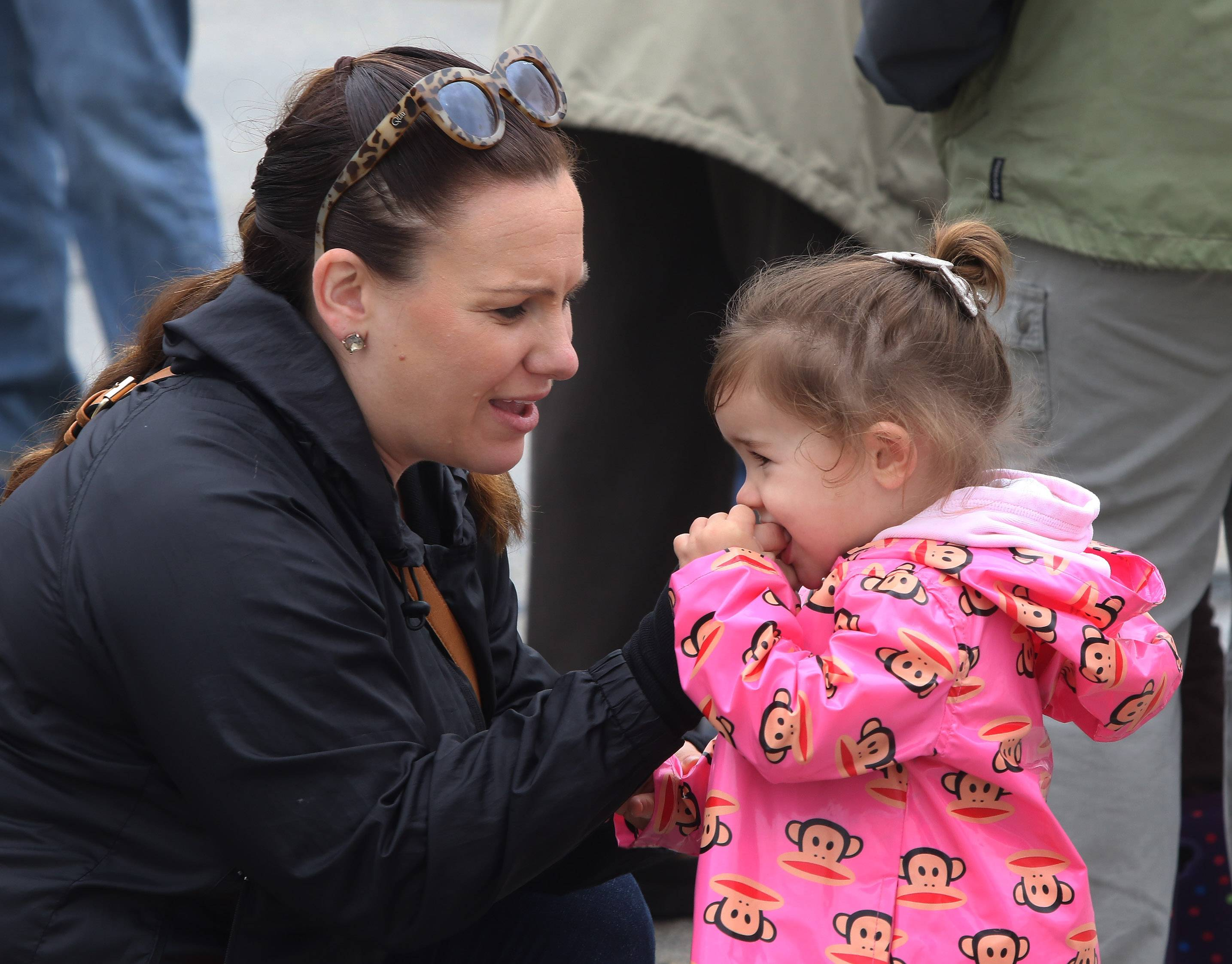 Kelly Sauter of Arlington Heights gives her daughter, Gemma, 2, a piece of maple sugar to taste Sunday during the maple syrup hike Sunday hosted by the Lake County Forest Preserve at Ryerson Woods near Riverwoods.