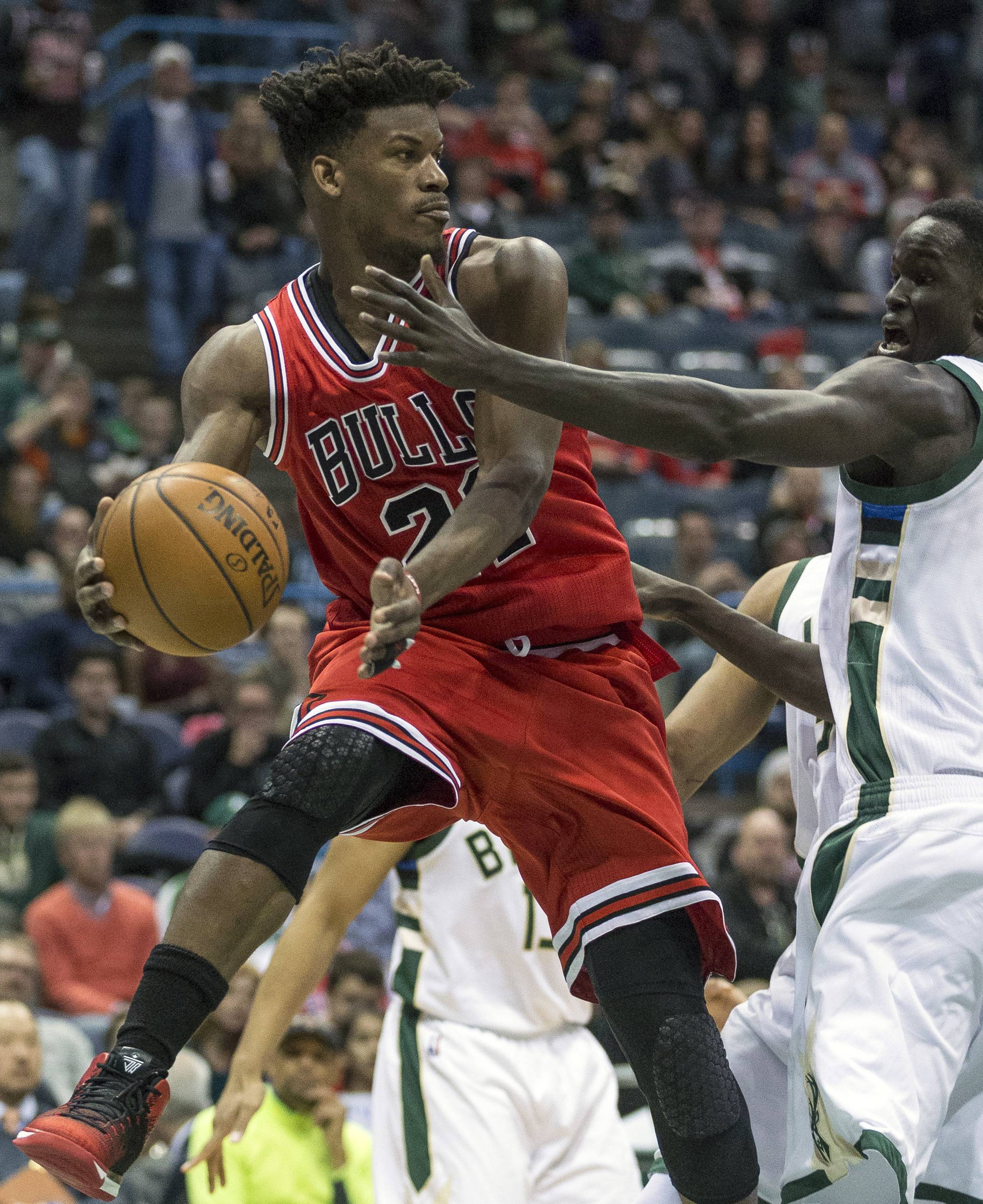Chicago Bulls' Jimmy Butler looks to pass the ball as Milwaukee Bucks' Thon Maker defends during the second half of an NBA basketball game Sunday, March 26, 2017, in Milwaukee. (AP Photo/Tom Lynn)
