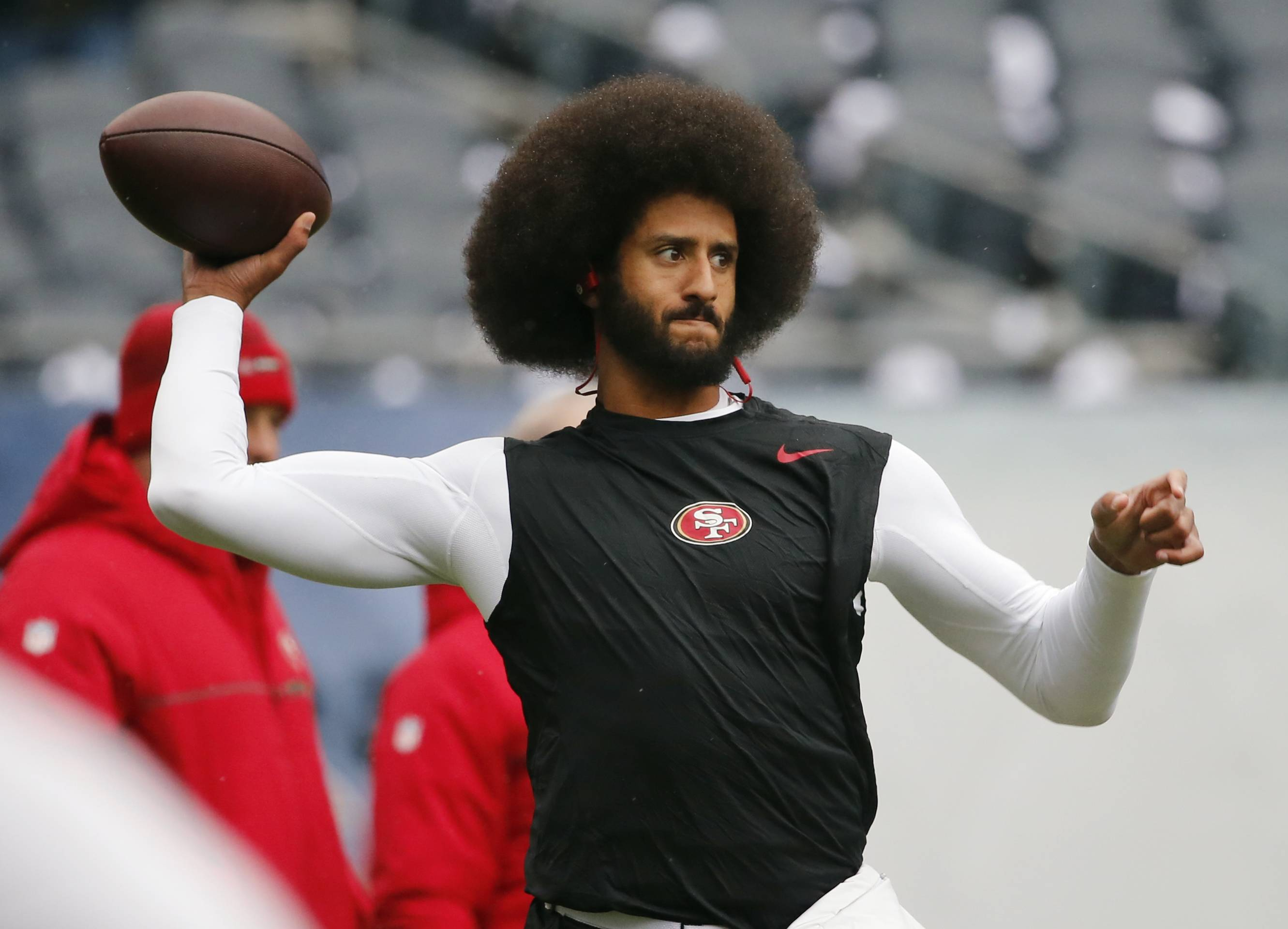"FILE — In this Dec. 4, 2016, file photo, San Francisco 49ers quarterback Colin Kaepernick warms up before an NFL football game against the Chicago Bears. Spike Lee said on Instagram Sunday, March 19, 2017, that it was ""fishy"" that Kaepernick, now a free agent, hadn't been signed."" (AP Photo/Charles Rex Arbogast, File)"
