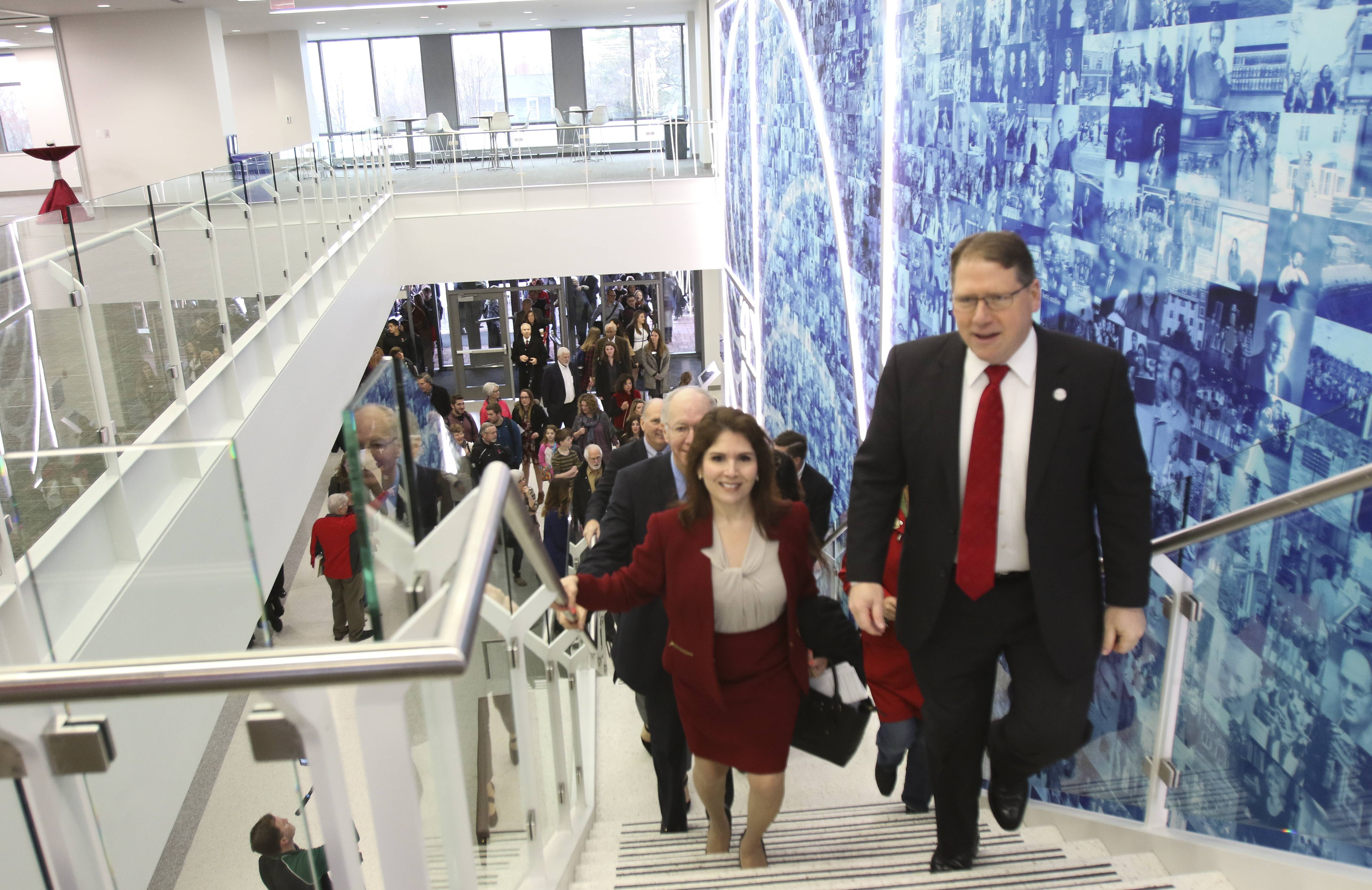 North Central College President Troy Hammond leads visitors, including Lt. Gov. Evelyn Saguinetti, left, into the school's new Science Center on Monday in Naperville.