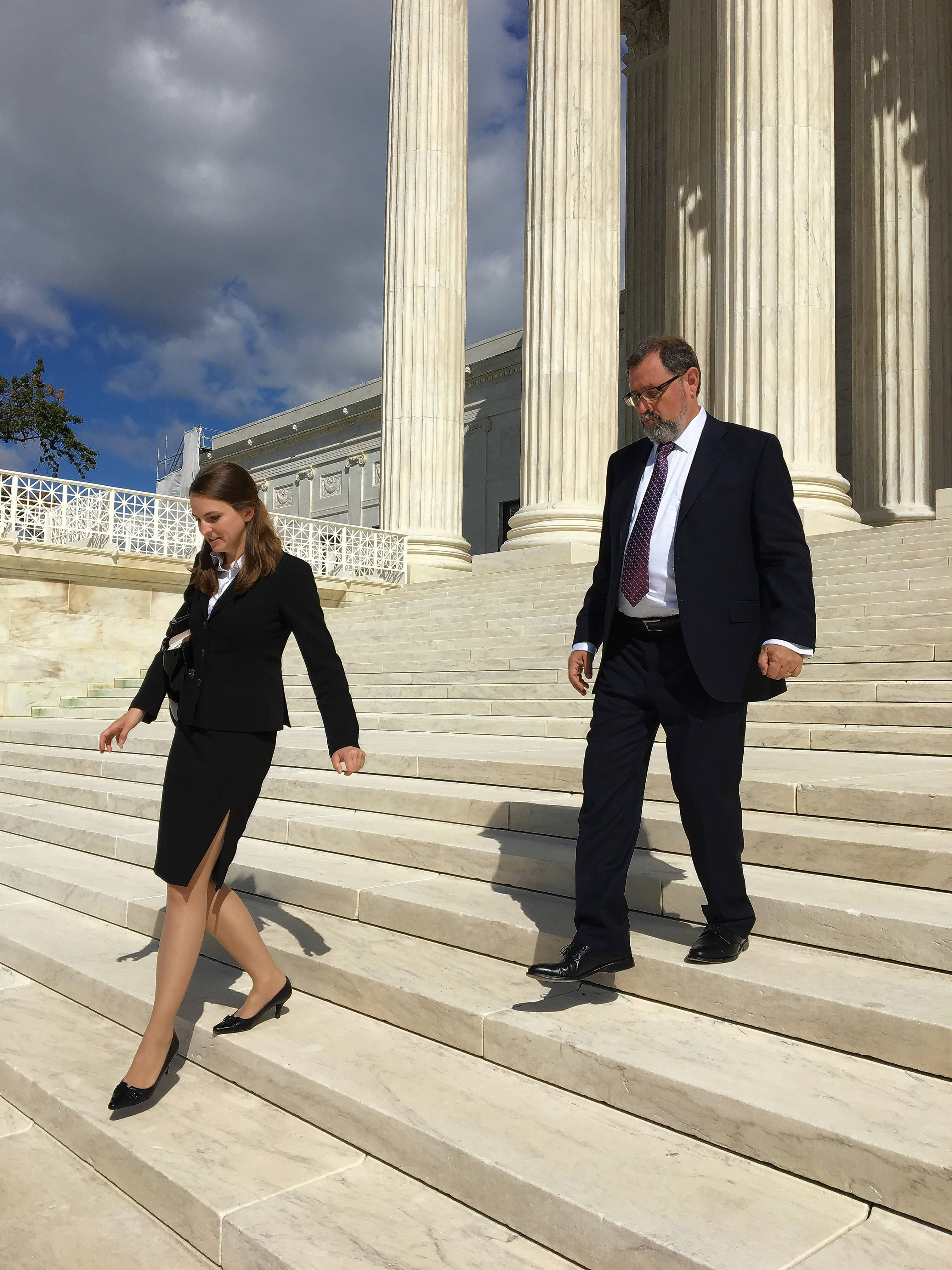 Arlington Heights attorney Stanley Eisenhammer, top, was victorious in a search and seizure case he argued before the U.S. Supreme Court. Associate attorney Pamela Simaga, bottom steps, assisted in the preparation.