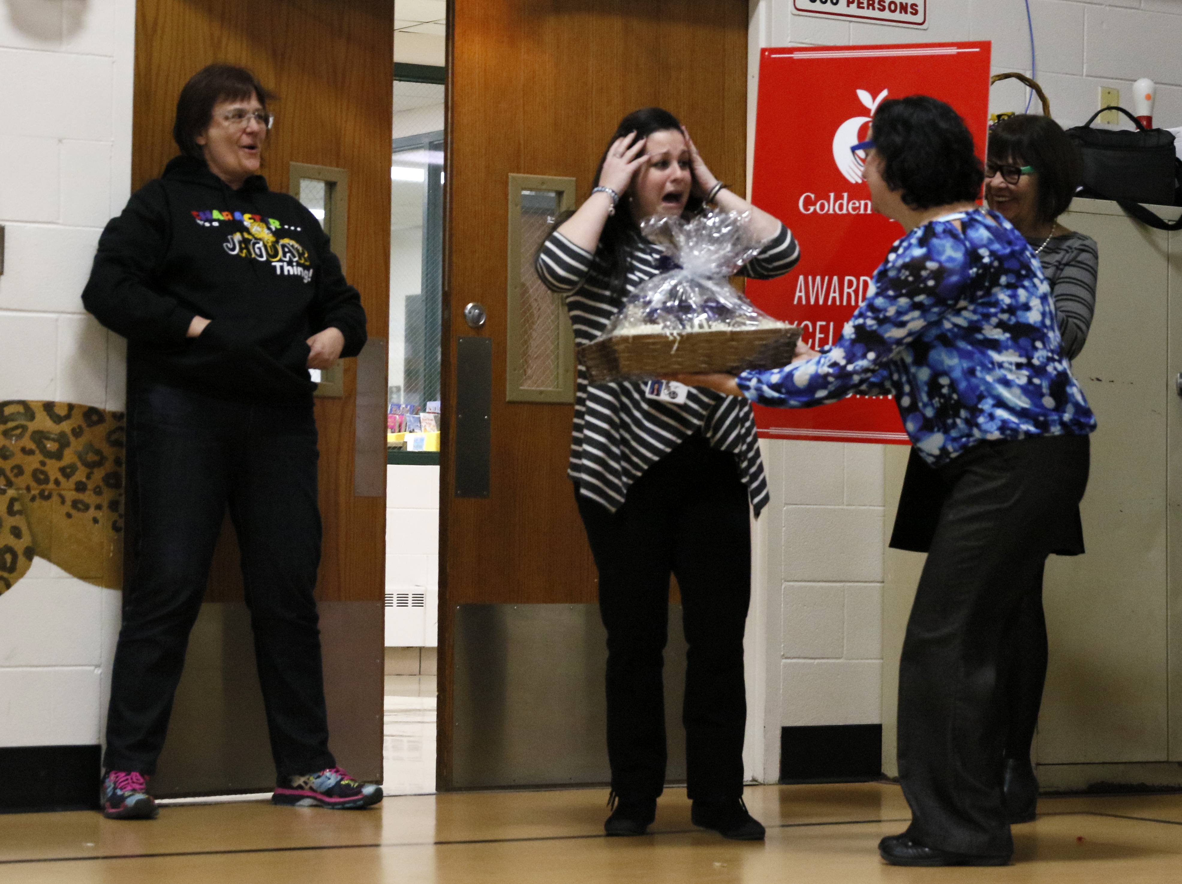Jennifer Eggert, an instructional technology coach at DuJardin Elementary School in Bloomingdale, reacts to being named a Golden Apple recipient during an assembly to surprise her with the award.
