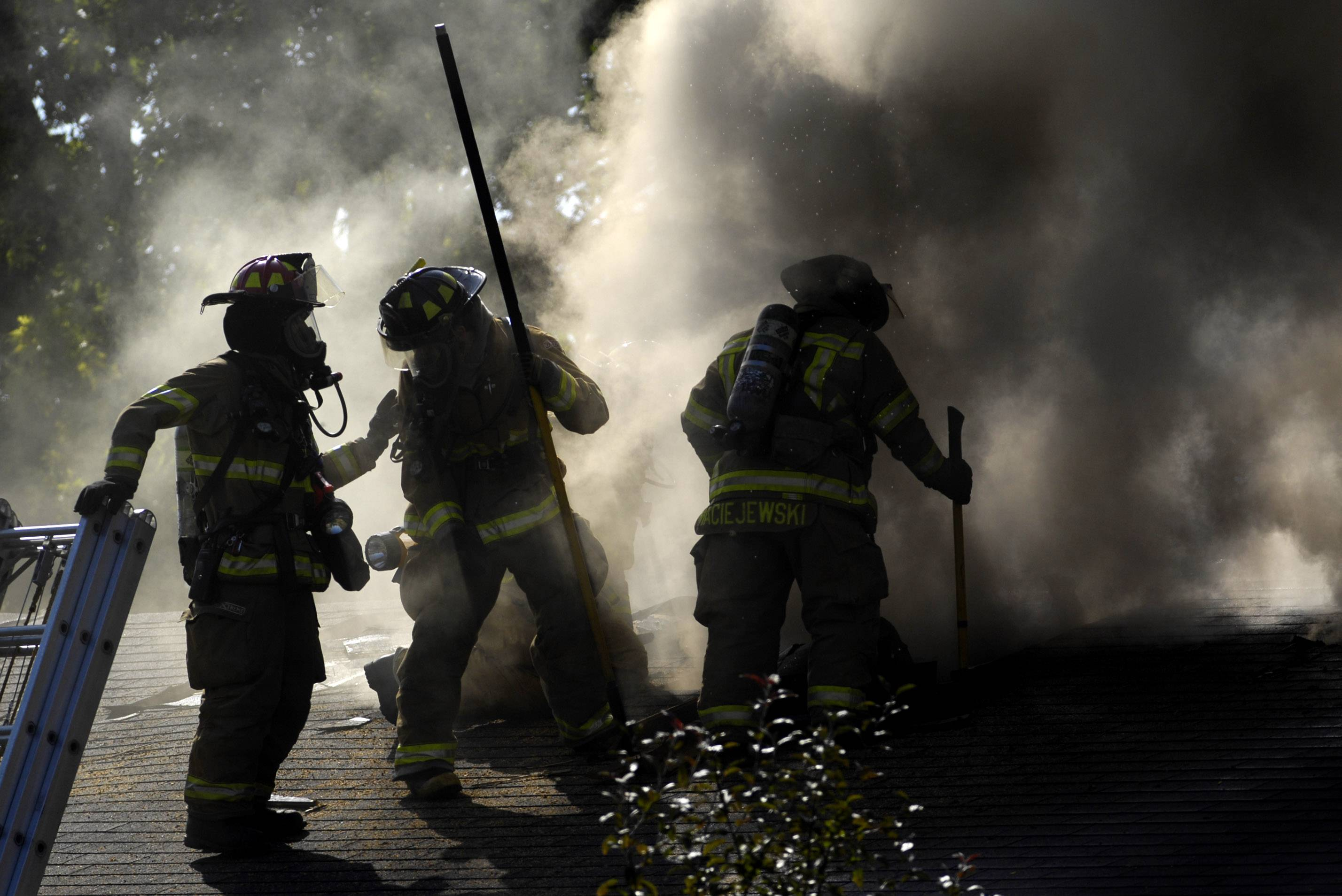 Sycamore firefighters vent the roof at a house fire at in Maple Park in September 2008. A new study of Hanover Park firefighters aims to measure the physiological impacts of the job that sometimes can pose greater danger than a fire itself.