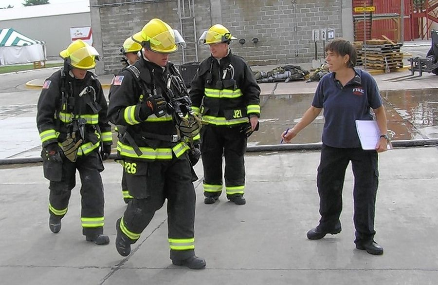 Professor Denise Smith of Skidmore College in New York works with Hanover Park firefighters in a previous research study at the University of Illinois Fire Service Institute.