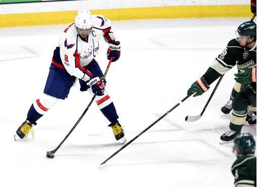 Oshies Ot Goal For Caps Beats Wild 5 4 After Ovi Hat Trick