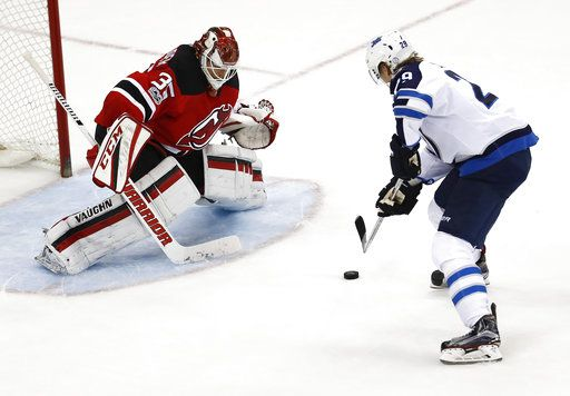 innovative design 7c9b6 f0e6b Patrik Laine scores in shootout, Jets rally to beat Devils