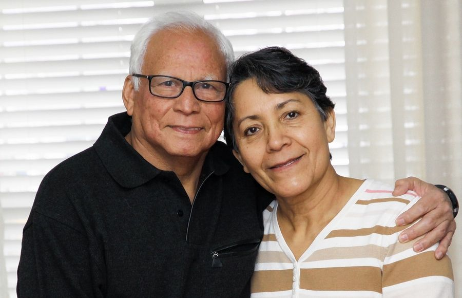 Plainfield resident Manuel Hernandez, with his wife, Lorena, has returned to normal activities following a complex series of surgeries at the Edward Neurosciences Institute to treat a tumor on his spine.
