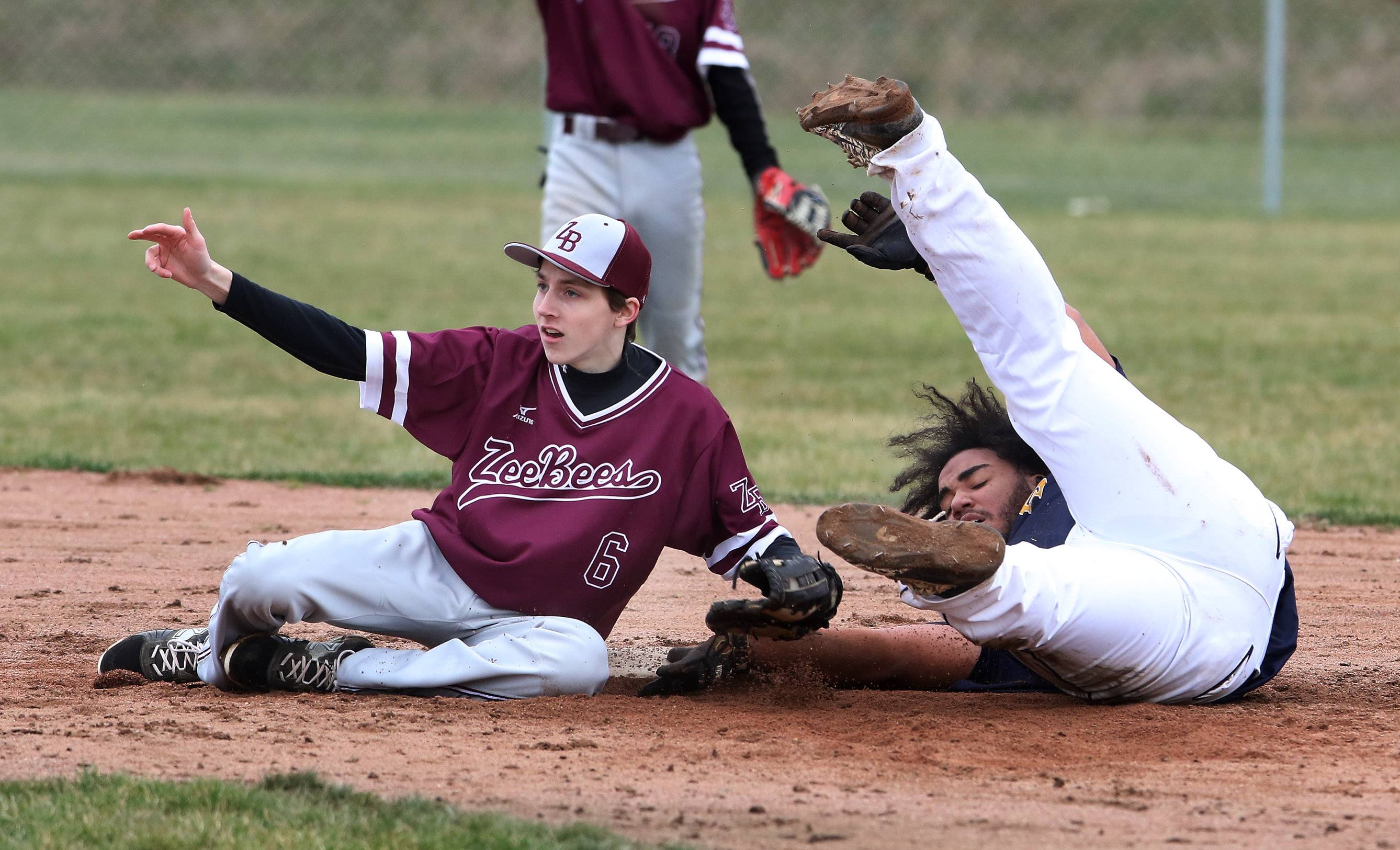 Zion-Benton second baseman Ryan Green tags out Round Lake's Amadeus Pope after he tried to extend a hit into a double in the second inning Wednesday at Round Lake High School.