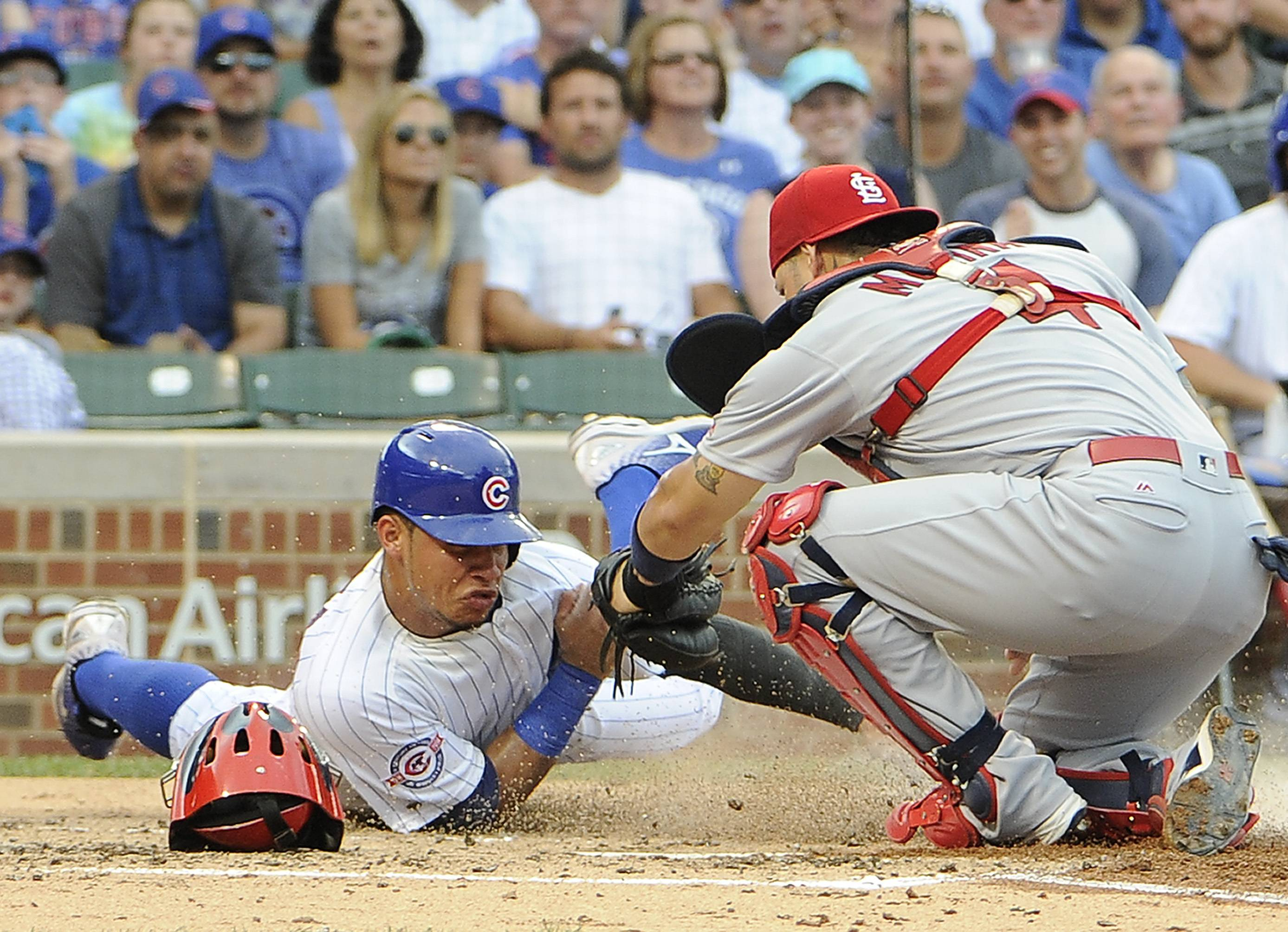 St. Louis Cardinals catcher Yadier Molina, right, tags out Willson Contreras of the Cubs in a game at Wrigley last August. The Cardinals missed the playoffs last season but many expect they could earn a wild-card bid this year.