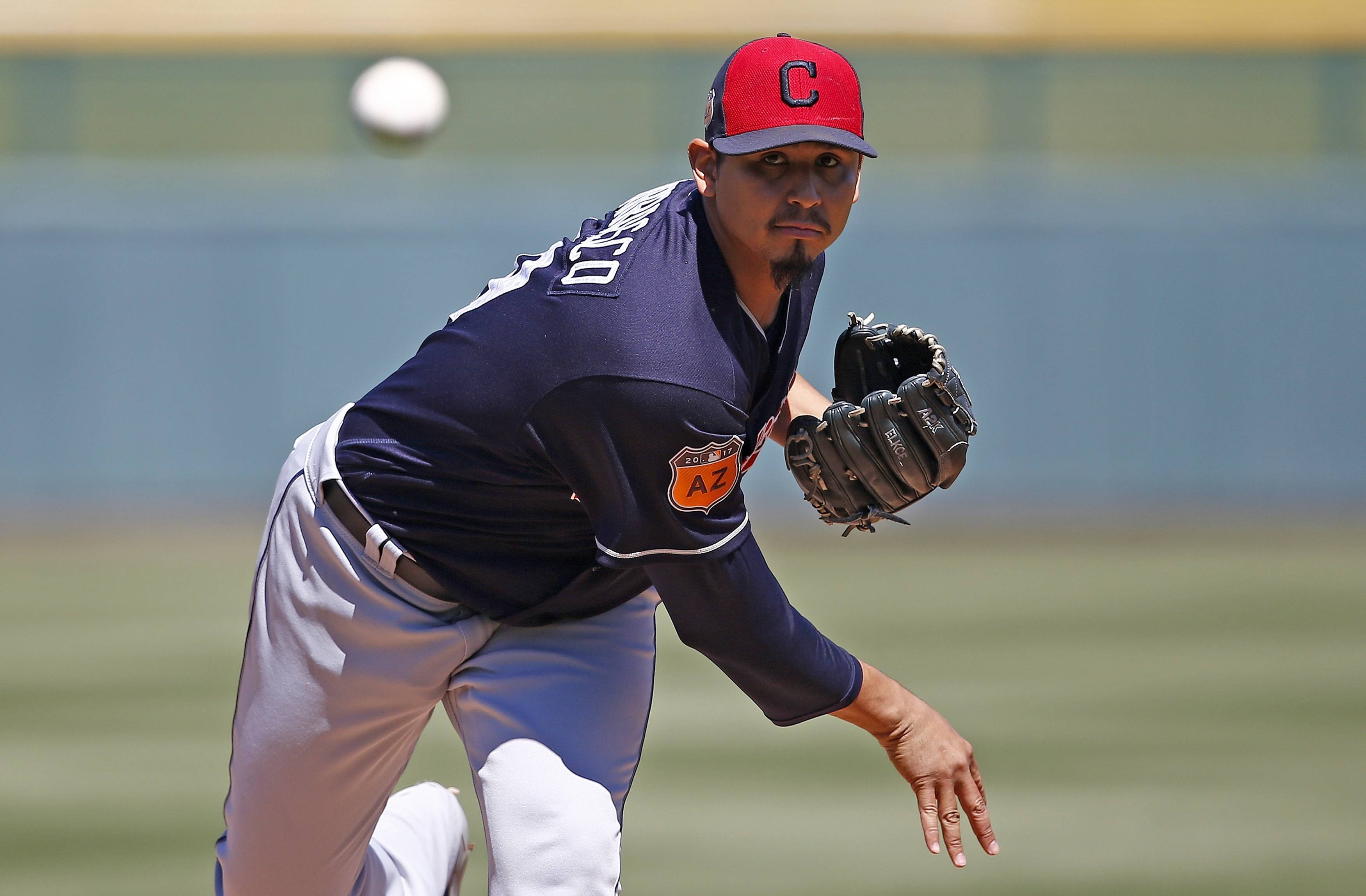 Cleveland Indians' Carlos Carrasco warms up during the first inning of a spring training baseball game against the Chicago Cubs on Friday, March 24, 2017, in Mesa, Ariz. (AP Photo/Ross D. Franklin)