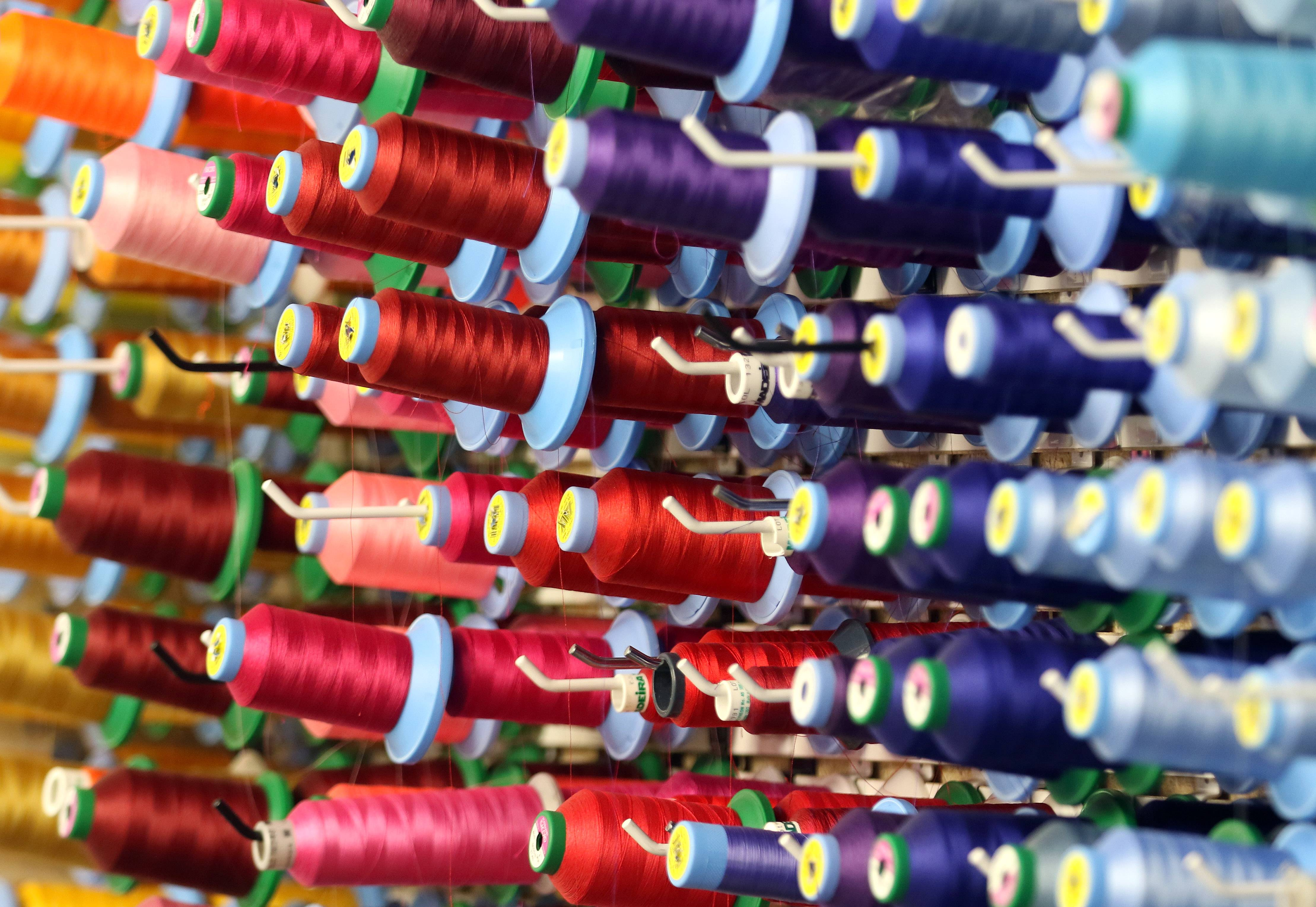 Spools of thread are for Nancy Solomon's new embroidery machine. Solomon is the owner of Melon Ink in Lake Zurich. She started the business in her home years ago. She has moved into a shop and now expanded to the shop next door.