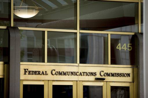 FILE - This June 19, 2015, file photo, shows the Federal Communications Commission building in Washington. Republicans in the House have followed the Senate in overturning an Obama-era broadband privacy regulation that set tough restrictions on what companies like Comcast, Verizon and AT&T could do with customers' personal information. It still needs President Donald Trump's signature. Consumer advocates and Democrats have slammed Republicans for gutting the Federal Communications Commission's regulation, saying it will leave Americans online unprotected; Republicans and industry groups counter that spiking the rule just maintains the status quo. (AP Photo/Andrew Harnik, File)